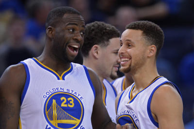 Golden State Warriors' Draymond Green (23) and Golden State Warriors' Stephen Curry (30) share a laugh before playing the Charlotte Hornets at Oracle Arena in Oakland, Calif., on Monday, Jan. 4, 2016. (Jose Carlos Fajardo/Bay Area News Group)